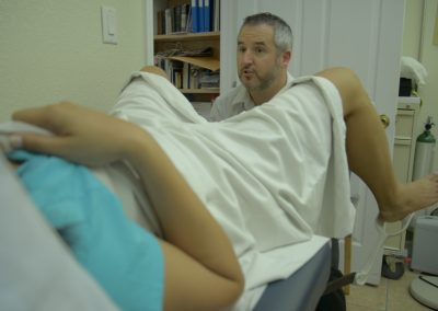 Karly (Michelle Morgan) at an uncomfortable moment with her doctor (Shane Delaney)