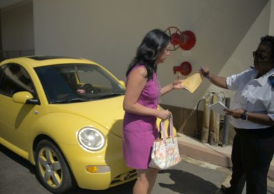 Karly (Michelle Morgan) gets a parking ticket from Andrea Knox