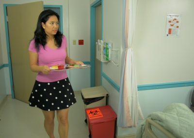 Karly (Michelle Morgan) volunteering at the hospital - this is seconds before the drops the tray