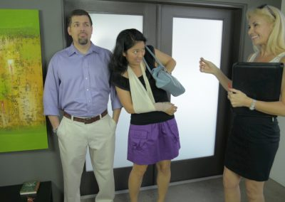 Nik (Dominic Wheaton) helps Karly (Michelle Morgan) find an apartment with real estate agent (Delia Slater)